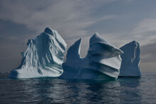 Icebergs On Sea Against Sky During Winter
