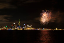 Firework Display At Night Against Cityscape