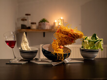 Food And Drink Levitating Over Dining Table At Home
