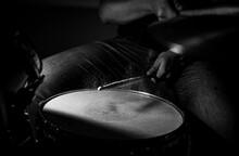 Close-up Of Man Playing Drum In Darkroom
