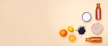 Horizontal Banner With Bottles Of Kombucha Tea, Scoby, Brew, Sugar And Citrus Fruits For Additional Flavors On Yellow Pastel Background. Copy Space. Ingredients For Preparing Fermented Drink. Flatlay