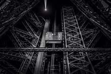 Low Angle View Of Eiffel Tower With Elevator