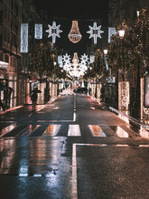 Illuminated Street Lights On Road In City At Night Christmas Vibes