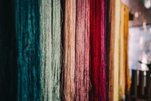 Close-up Of Multi Colored Threads Hanging At Market