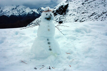 Cute Snowman On Top Of A White Snowy Mountain With Winter Landscape
