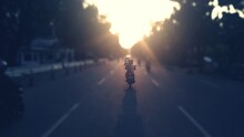 Tilt-shift Image Of Person Riding Motorcycle On Street