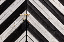 Detail Of Old Wooden Gates, Doors With Cracked Paint. Black And White Old Wooden Planks