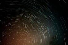 Low Angle View Of Rotating Stars Against Sky At Night