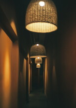 Illuminated Light Bulb Hanging From Ceiling