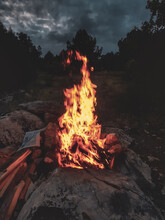 Bonfire On Wooden Structure Against Sky