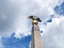 Low Angle View Of Seagull Statue Against Sky