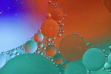 Full Frame Shot Of Water Drops Against Orange Sky
