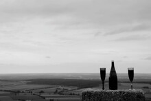 Panoramic Shot Of Bottle  And Landscape Against Sky