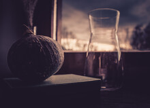 Close-up Of Drink In Glass And Pumpkin On Table