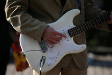 Electric Guitar In The Hands Of A Street Musician