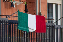 Green, White And Red Towels On Balcony Arranged Like A Flag In Italy During Coronavirus Lockdown
