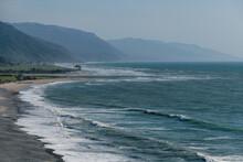 Scenic View Of Gentle Annie Beach By The Tasman Sea Against Sky