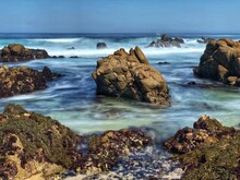 Beautiful Rocky Coastline Landscape Of Waves Crashing On Beach Along Pacific Groves Scenic Drive.