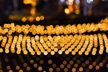Defocused Image Or Bokeh Of Illuminated Lights At Night