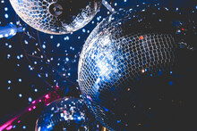 Disco Balls Reflect Light At The Party