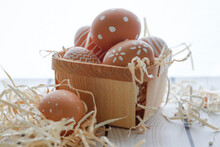 High Angle View Of Easter Eggs In Basket On Table