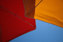 Low Angle View Of Shade Umbrellas Against Clear Sky