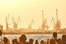 Group Of People At Commercial Dock Against Clear Sky