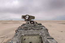 Army Tank With Bullet Holes On The Beach