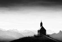 Discrete Chapel On Mountain Against Sky
