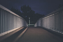 Empty Footbridge Against Sky At Night