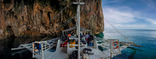 A Dive Boat Moored In The Shelter Of A Cave On Gato Island Near Malapascua In The Philippines