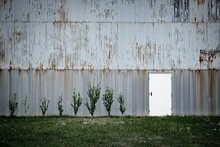 Old Barn On Field Against Wall