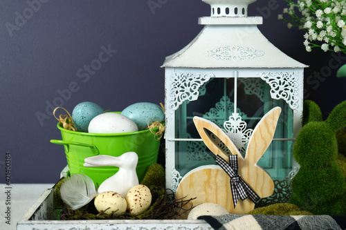 Obraz Easter farmhouse vignette with bunnies, Easter eggs and buffalo plaid check. - fototapety do salonu