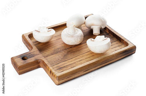Wallpaper Mural Cutting board with mushrooms on white background