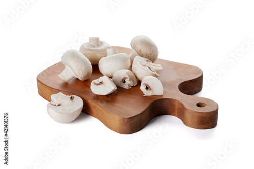 Photo Cutting board with mushrooms on white background