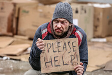 Poor Homeless Man Begging For Food Outdoors On Winter Day