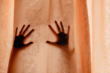 Shadow Of Hands On Curtain