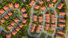 Top View Of The Resident Houses With Red Tiled Roof On The Green Grass, Architecture, Building Concept.