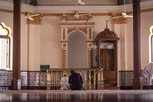 Rear View Of Man Sitting In Mosque