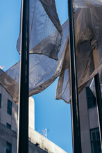 Low Angle View Of Building Against Sky With Flag In Wind