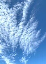 Clear Blue Sky With White Cumulus Clouds, Amazing Vertical Puffy Cotton Like Clouds