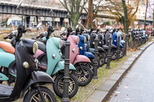 Motorbikes Parked On Street In City
