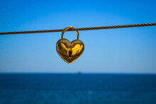 Close-up Of Heart Shape Hanging On Rope Against Clear Sky