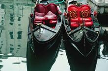 Gondolas Moored In Canal. Venice. Italy.