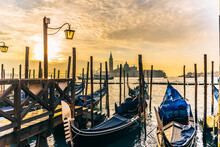 View Of Wooden Post In Venice At Sunrise