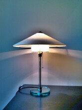 Illuminated Lamp On Table At Home
