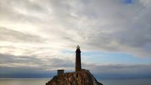 Lighthouse On A Rock Against The Sky