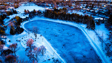 High Angle View Of Trees And A Frozen Lake Use For Ice Skating
