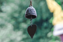 Close-up Of Heart Shape Hanging On Metal