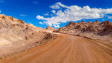 Dirt Road At Desert Against Sky